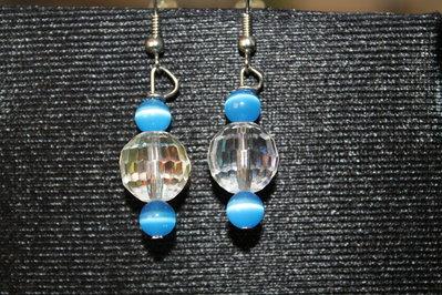 Orecchini a sfera swarovski con perle azzurre