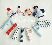 Filippi: una ghirlanda blu, celeste e rossa per decorare con in suo nome la cameretta