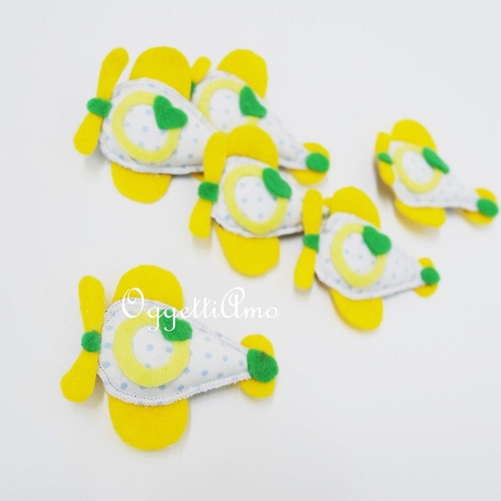 Aeroplanini colorati per le bomboniere del battesimo, comunione o cresima del tuo bambino