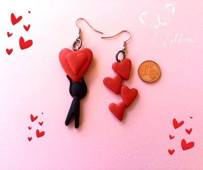 Maxi orecchini love - cascata di cuori e sagoma aggrappata a cuore rosso - orecchini san valentino