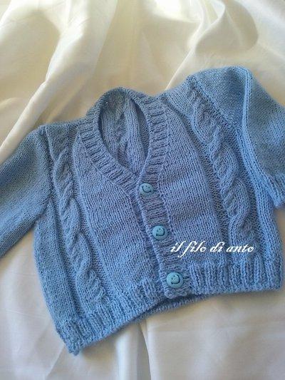 Giacchino / golfino / cardigan/ maglietta  azzurro con particolari trecce