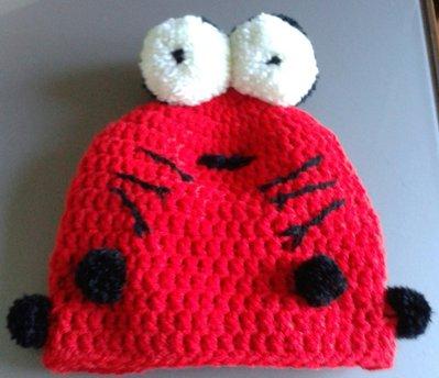 Cappellino in lana a forma di coccinella