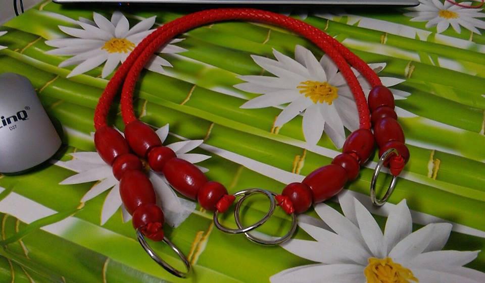 coppia di manci similpelle con perle di olivo rosso