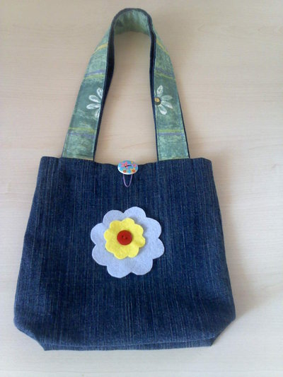 Borsetta jeans con applicazione floreale