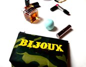 Pochette - bustina - in tessuto plastico con applicazione in ecopelle