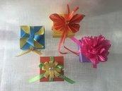 Scatoline in cartone rigido quadrate vari colori con decorazioni diverse
