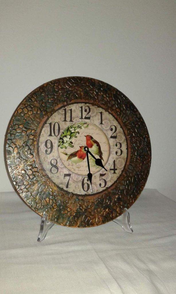 L'orologio com imitazione rame