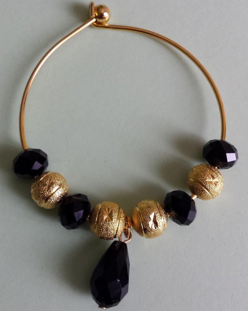 Bracciale metallo dorato con cristalli neri