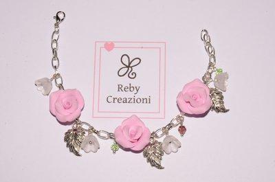 Bra013- Braccialetto rose rosa