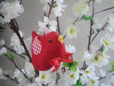 Uccellino primavera rosso
