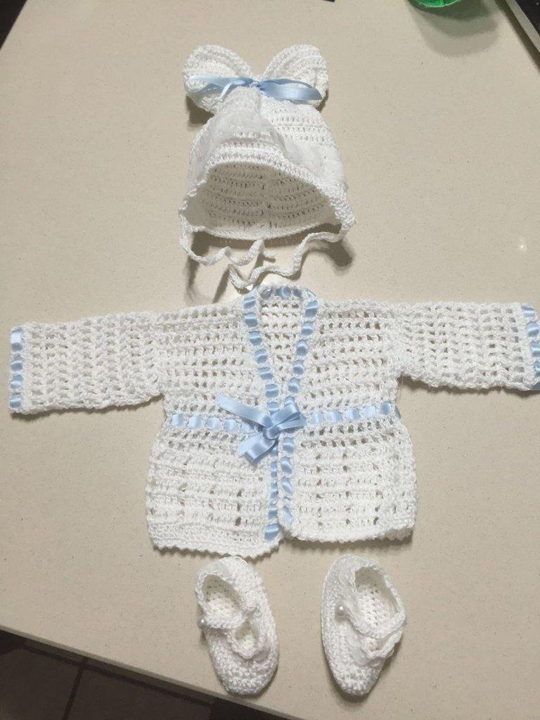 Copri fasce neonato all'uncinetto