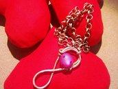 collana con ciondolo infinito in rame con perla rosa inserti swarovski