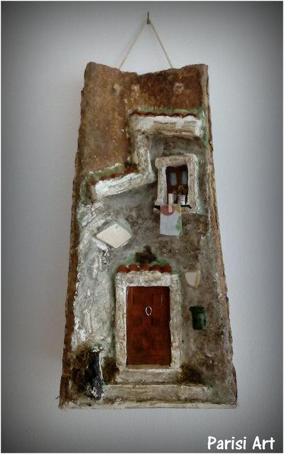Antica tegola decorata a mano