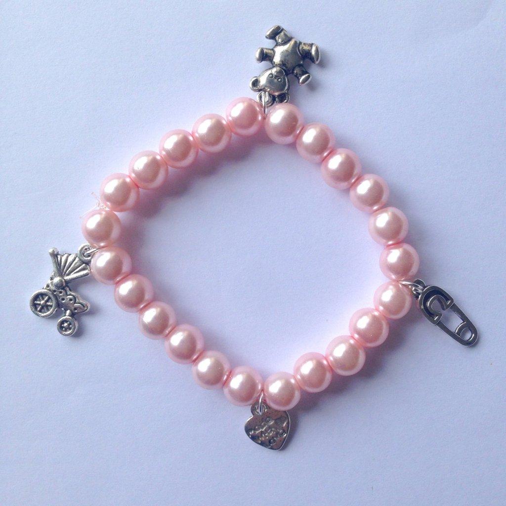 Braccialetto elastico con perle rosa confetto e ciondolini a tema bebè, per future mamme