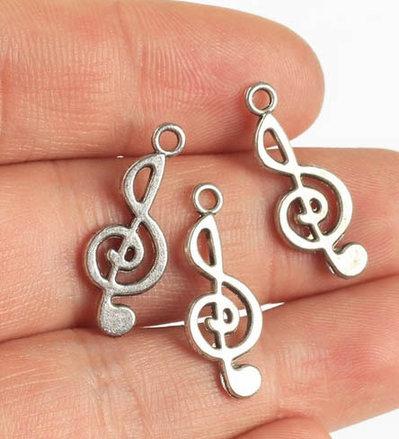 Lotto 10 charms chiave di violino