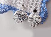 orecchini in acciaio con cuore bombato