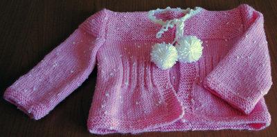 Coprifasce in lana rosa con pois  con pon pon in lana bianca realizzato ai ferri
