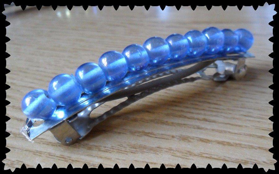 Ferma capelli con molla di perline blu trasparenti