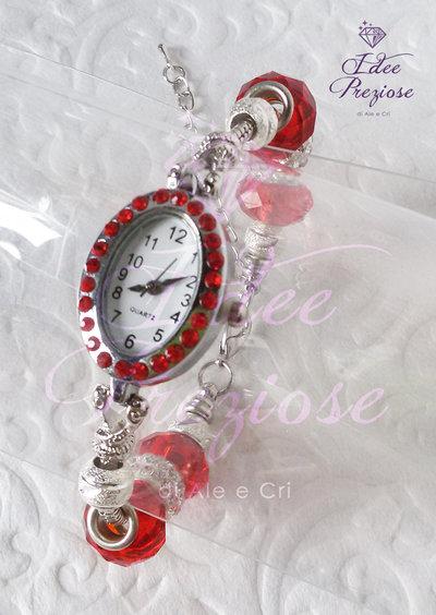 Orologio da polso con quadrante ovale e pietre rosse