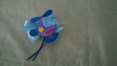Bomboniera aeroplanino in gomma crepla con fiocco in tulle con confetti