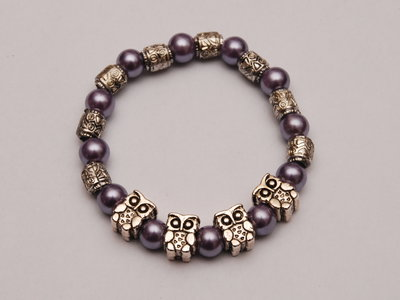 bracciale elastico con perle e gufi