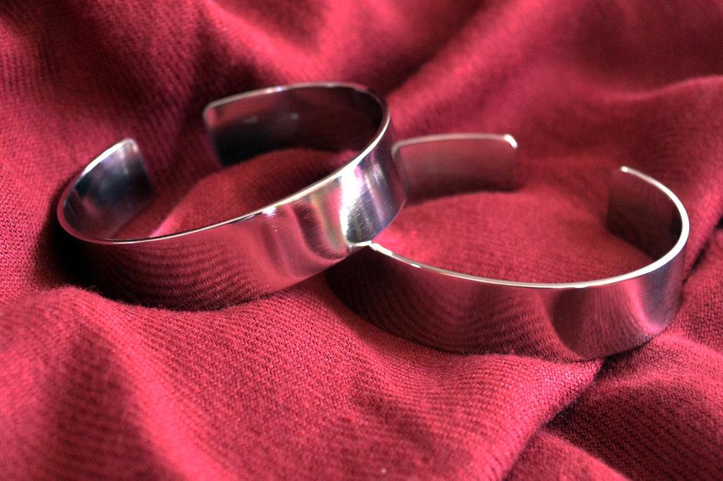 Bracciale specchiato fascetta in acciaio Inox