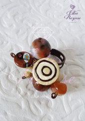 Anello in metallo ramato con pietre e mezzicristalli sulle tonalità del marrone