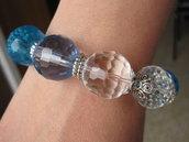 Bracciale elastico pietre trasparenti,azzurre e blu