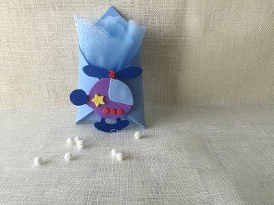 Bustina in gomma crepla azzurra con un aeroplanino sul davanti multicolore