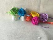 Confetti confezionati in cellofane con rosa colorata  in carta velina