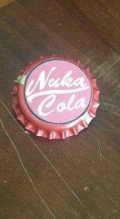 Nuka Cola spilla.