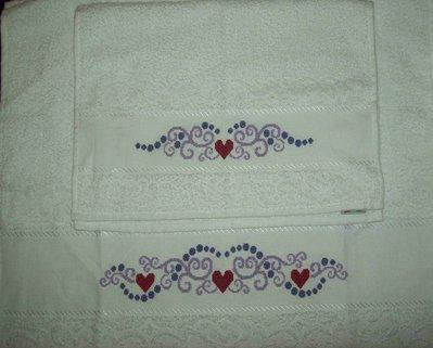 Coppia di asciugamani a punto croce