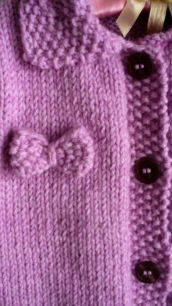 Cappottino a maglia rosa