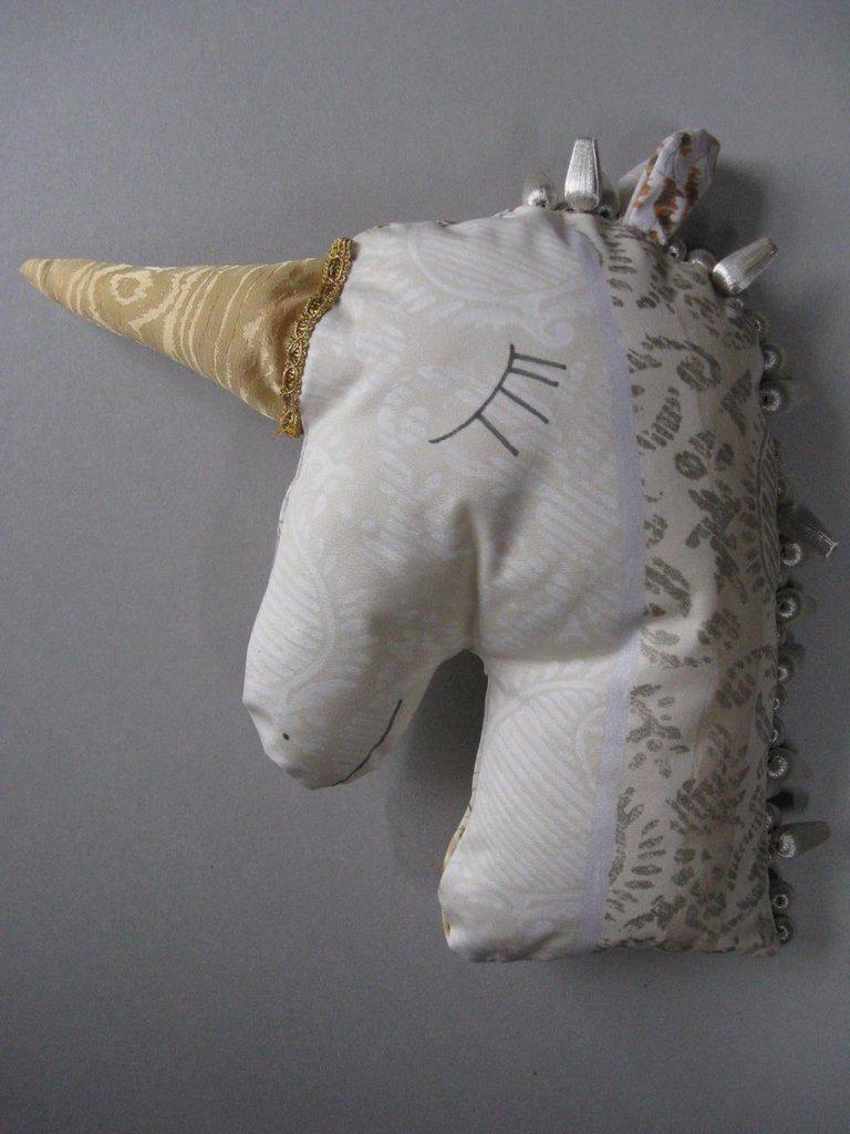 Cuscino dell'unicorno d'oro