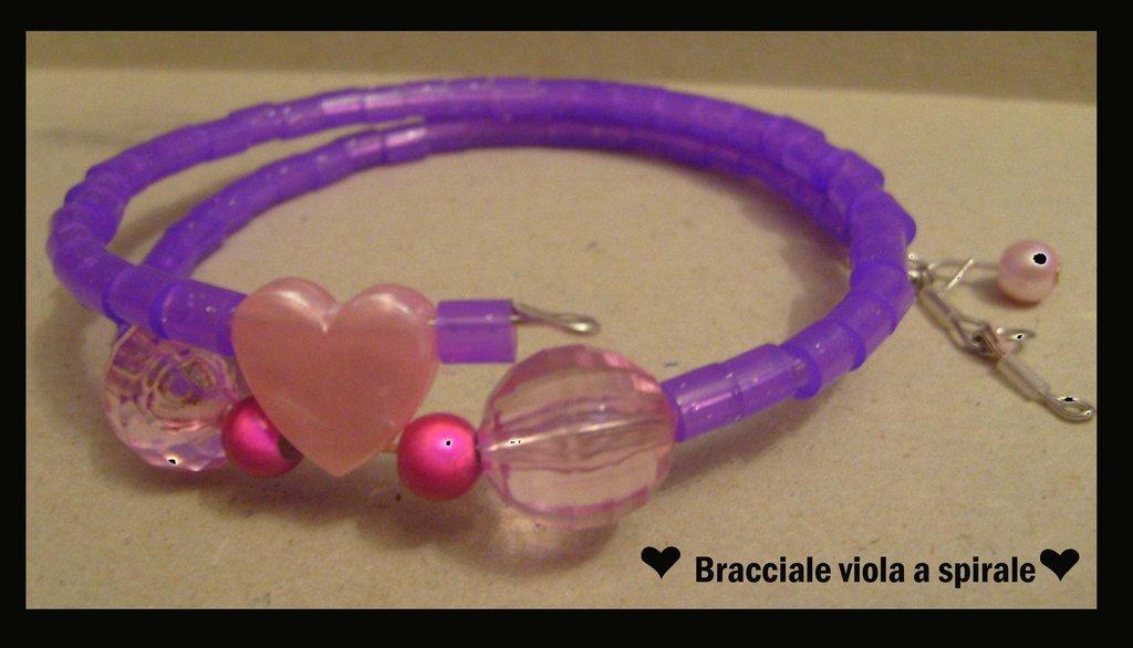 Bracciale perline viola e rosa con cuore rosa