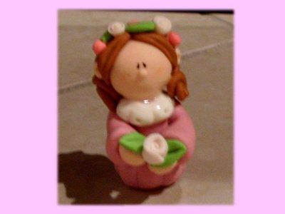 Bambolina con rose