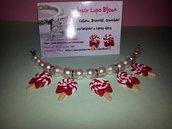Bracciale e orecchini con perle e lecca lecca in fimo rosso e bianco con fiocco