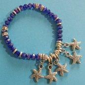 Bracciale elastico con cristalli blu e stelle marine
