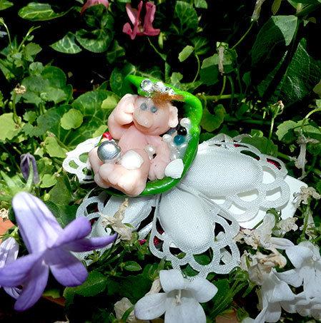 Bomboniera dolci neonati nelle culle