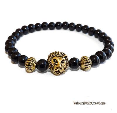 Bracciale elastico artigianale uomo testa di leone  perle nere agata