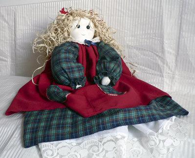 Bambola portaoggetti, in tessuto.