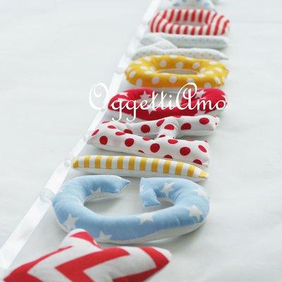 Giacomo: una ghirlanda di lettere di stoffa imbottite per decorare la cameretta con il suo nome
