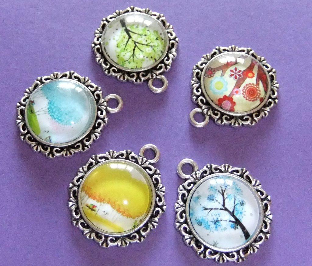 Ciondoli o Cabochon ovali o rotondi in vetro con albero della vita o sole/luna..in omaggio ciondolo con l'iniziale del vostro nome o il segno zodiacale