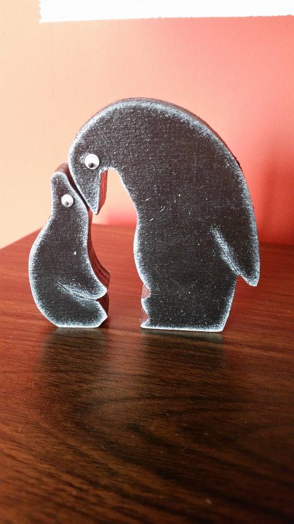 Pinguino a incastro in legno