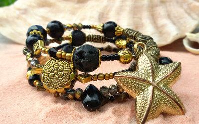 Bracciale spirale nero dorato pietre dure semi preziose stelle marine mare