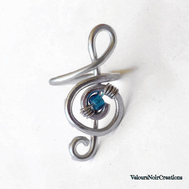 Anello chiave di violino creato a mano in metallo