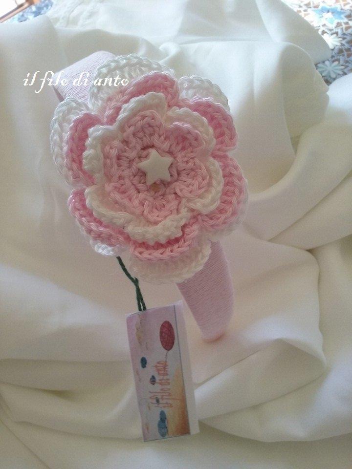 Cerchietto per capelli rosa con fiore e stella