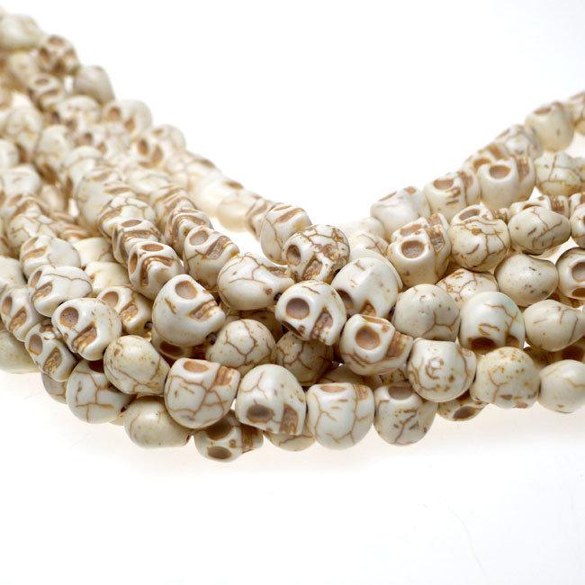 10 Perle Teschio 10 mm aulite col. bianco