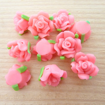 10 Rose in Fimo 12 mm perle col. fucsia