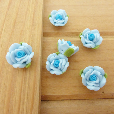 6 Rose in Fimo 15 mm perle col. celeste